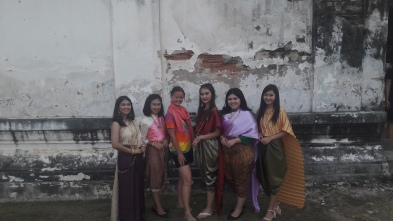 Photo with locals, they all have dressed in thai silk outfits